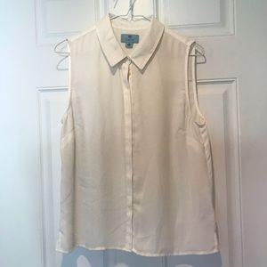 White sleeveless button down blouse